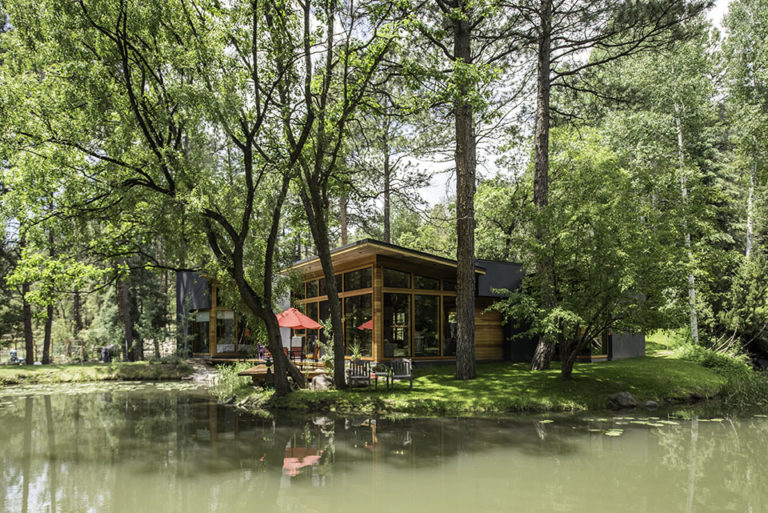 exterior of a home on a pond